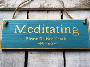 Meditating Please Do Not Knock. Namaste. Sign
