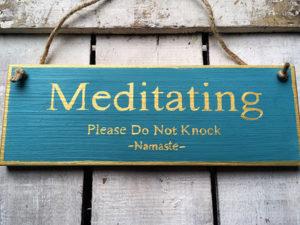 Meditating Please Do Not Knock. Namaste. Sign